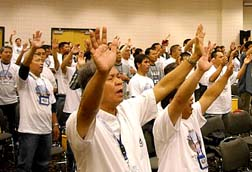 Members of Couples for Christ take part in a praise and worship session during the organization's Oct. 2-3 national conference for men.