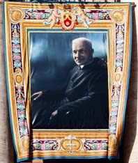 A tapestry showing St. André Bessette hangs from St. Peter's Basilica during the October 17 canonization ceremony in St. Peter's Square.