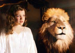 Georgie Henley is pictured with a lion named Aslan, voiced by Catholic actor Liam Neeson, in the movie The Chronicles of Narnia: The Voyage of the Dawn Treader.