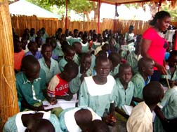 A Grade 2 Classroom at one of three schools 'under the trees' in southern Sudan that Atem Martino Kunjok helped establish