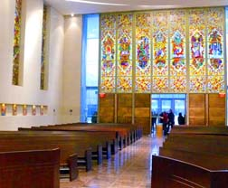 Windows depicting the seven traditional steps to the priesthood adorn the back wall of the new chapel.