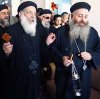 Coptic Orthodox priests pray in Alexandria Egypt, in the house of a victim of the Jan. 1 bomb attack outside an Orthodox church.
