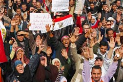 Demonstrators continued their opposition to Egyptian President Hosni Mubarak with a large gathering in Tahrir Square in Cairo Feb. 8.