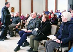 Fr. Stefano Penna, dean of Newman Theological College, speaks to visitors in the college chapel.