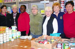 Volunteers and Sisters of Providence ready themselves to choose foodstuffs form the inner city needy.