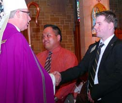Archbishop Richard Smith welcomes Tyler Lacoste at the Rite of Election March 13.