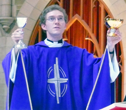 Fr. Dean Dowle celebrates Eucharist at St. Joseph's Basilica April 4. The new English translation of the Roman Missal will be implemented in Canada on the First Sunday in Advent.