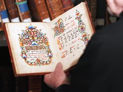 Fr. Robert Taft holds a rare book in the library of the Pontifical Oriental Institute in Rome.