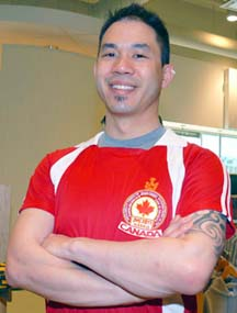Erwin Fung models the soccer jersey that Canadians will wear at World Youth Day in August.