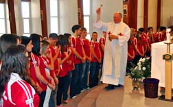 Oblate Father Roman Majek blesses 80 young people from Edmonton's Polish Holy Rosary Parish who will attend World Youth Day in Madrid.