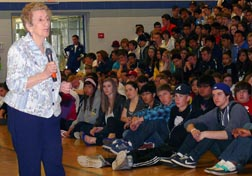 Holocaust survivor Eva Olsson urged students at Edmonton's St. Francis Xavier High School never to stand idly by in the face of evil.