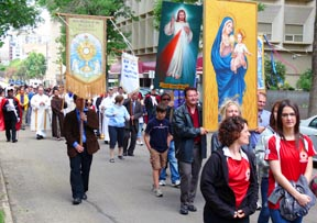Catholics of various organizations show their colors in the procession.