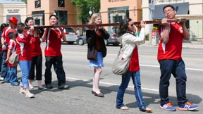 Young people carry a replica of the World Youth Day cross down Jasper Avenue