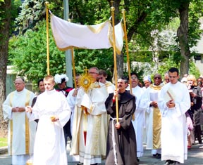 Archbishop Richard Smith carried the Blessed Sacrament during the Corpus Christi procession.
