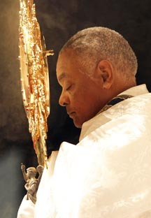 Atlanta Archbishop Wilton Gregory clutches the monstrance containing the Eucharist during morning adoration at the Atlanta Archdiocese's 2007 Eucharistic congress.
