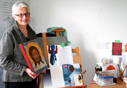 Iconographer Matthia Langone shows a finished icon in her Vancouver studio.