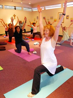Yoga instructor Donna Kocian works with her class at St. Francis of Assisi Church in Virginia.