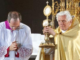 Pope Benedict XVI leads Benediction of the Eucharist during the WYD prayer vigil Aug. 20. Hundreds of thousands of youth endured driving rain and wind at the start of the service