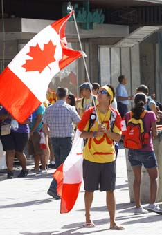 Jeremiah Sacay, 23, waves Canada's flag during World Youth Day in Madrid Aug. 19. Up to a million pilgrims were expected to attend various programs during the six-day celebration culminating with Sunday Mass with Pope Benedict XVI