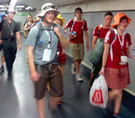 Pilgrims, accompanied by Archbishop Richard Smith, dash from one event to the next via the Madrid subway system.