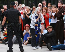 Rose Berger, a Catholic who is associate editor at Sojourners magazine, bows to her colleagues before being arrested during an Aug. 30 protest in front of the White House against the proposed Keystone XL Pipeline.