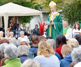 Archbishop Richard Smith urged parishioners to carry on their founders' legacy.