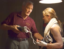 Clint Eastwood and Hilary Swank star in a scene from Million Dollar Baby, a film in which the gym owner removes his paralyzed fighter's breathing tube.