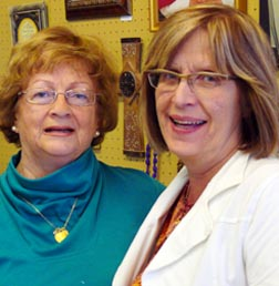 Helena Lieskovsky,left, and Donna Wallace of St. John of God Books offset book sale losses by selling music, gifts, rosaries and other religious items