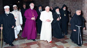 Pope Benedict walks with other religious leaders in the crypt of the Basilica of St. Francis in Assisi, Italy, Oct. 27.