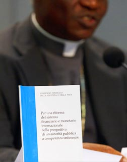 The Vatican's white paper on economic justice is seen at a press conference at its release Oct. 24.