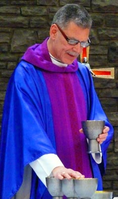 Fr. Roger Keeler celebrates Mass using the new English Missal Nov. 26 at St. Michael-Resurrection Church in Edmonton.