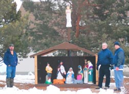 Cory Malloy, Bill James and Gordon Laroque erected the parish Nativity scene in front of St. Norbert's Church in Millet on Nov. 27.