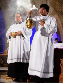 Arnulfo Jam-Camat is seen incensing the congregation during Vespers