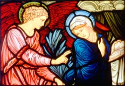 The angel Gabriel greets Mary in this church window depicting the Annunciation.