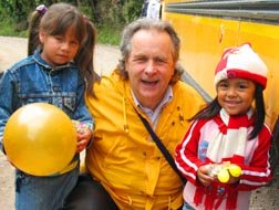 Calgary musician Denis Grady hugs two of his Guatemalan fans.