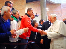 Pope Benedict is greeted by inmates as he arrives for a pastoral visit at Rebibbia prison in Rome.