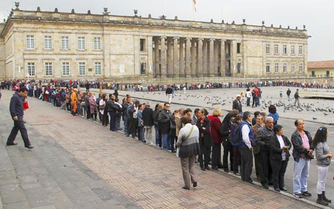 People wait in line to enter the cathedral of Bogota, Colombia, to see the capsule containing the blood of Blessed John Paul II Jan. 20. The blood will be on tour throughout the country.
