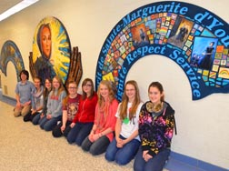 Jill Campbell, Jacylyn Repchuk, Kayla Zimmerman, Amy Dittrich, Chenel Kimber, Lauren Henderson, Katie Henderson, Kayla MacIsaac and Thomas Fenton were among the 120 students at Ecole Sainte Marguerite d'Youville who painted the mural of the school's patron.