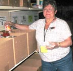 Pam DeLuca helps out at the Edmonton Food Bank.