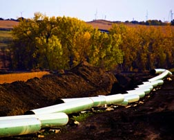 The disputed Keystone XL pipeline seen here under construction in North Dakota would carry Alberta crude oil through several states to Gulf Coast refineries.