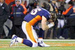 Denver Broncos quarterback Tim Tebow prays after the Broncos defeated the Pittsburgh Steelers in overtime in the National Football League AFC wild-card playoff game Jan. 8.