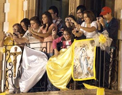 People on a balcony cheer and take photos as Pope Benedict leaves after celebrating a vespers service in Leon, Mexico, March 25.