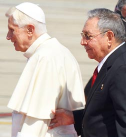 Cuba's President Raul Castro walks with Pope Benedict after the pope arrived in Cuba March 26.