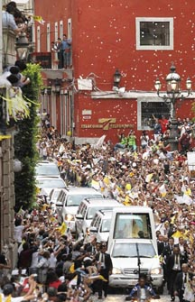 People cheer as the popemobile carrying Pope Benedict makes its way through the city of  Guanajuato, Mexico, March 24.