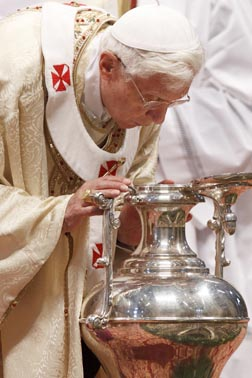 Pope Benedict breathes over chrism oil, a gesture symbolizing the infusion of the Holy Spirit, during Holy Thursday chrism Mass in St. Peter's Basilica at the Vatican April 5.