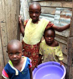 Safe drinking water eludes these children who live in corrugated metal and wood shacks without running water, electricity or a sewage system in Nairobi, Kenya.
