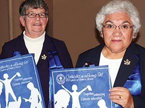 CWL members Margaret King and Beatrice Salmon display bags that will be given to league members attending the national convention in Edmonton in August.