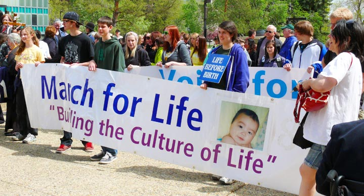 Hundreds of people marched through the centre of Edmonton in the fifth annual Alberta March for Life May 17.