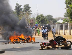 Debris blocking a road burns after a bombing at St. Finbar Catholic Church in the Nigerian city of Jos March 11. The bomb killed at least 10 people at the Church.