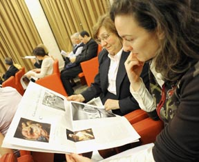 Women look a page of the Vatican newspaper L'Osservatore Romano during a news conference at the Vatican May 30.